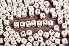 Bokstaven tärnar ordet - innehåll arkivfoton