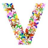 Bokstaven V utgjorde av massor av fjärilar av olika färger Arkivbild