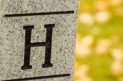 BokstavsH på stenstolpen Fotografering för Bildbyråer