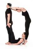 Bokstavsnollan som bildas av gymnastkroppar royaltyfri foto