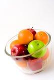 Bol de fruit (pommes et oranges) Photographie stock libre de droits