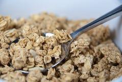 Bol de granola avec la cuillère Photos libres de droits