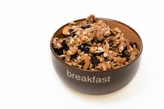 Bol de granola entière de grain d'isolement sur le fond blanc image stock