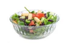 Bol de salade jetée en l'air Photos libres de droits