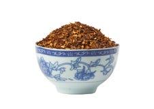 Bol de thé rouge desserré de Rooibos, d'isolement Images stock