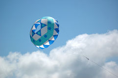 Bol kite in the sky. Blue decorated bol kite flying at the 2007 Barmouth Kite Festival in Barmouth, Wales, UK stock photos
