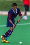 Bola adolescente del jugador del hockey Imagen de archivo