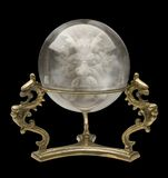 Bola cristalina con una cara del mago Imagen de archivo libre de regalías