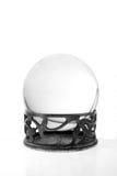 Bola cristalina contra blanco Fotos de archivo libres de regalías