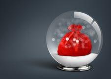 Bola da neve com saco de Santa para dentro, no fundo escuro com sp da cópia Imagens de Stock Royalty Free