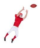 Bola de cogida del jugador de fútbol americano Fotos de archivo