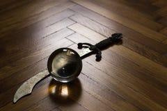 Bola de cristal com punhal Imagem de Stock Royalty Free