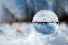 Bola de cristal en nieve Foto de archivo libre de regalías