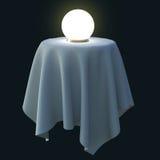 Bola de cristal que brilla intensamente en una mesa redonda Imagenes de archivo