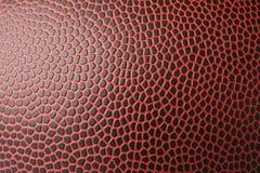 Bola de cuero del fútbol americano como fondo imagenes de archivo