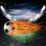 Bola de fogo do futebol no estádio Fotos de Stock Royalty Free