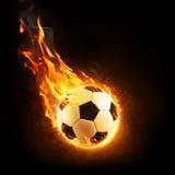 Bola de futebol ardente no movimento ilustração royalty free