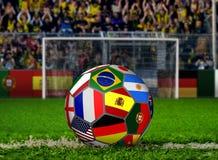 Bola de futebol com as bandeiras que enfrentam multidões Foto de Stock Royalty Free