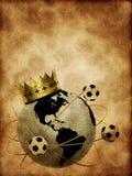 Bola de futebol com coroa e globo Foto de Stock Royalty Free