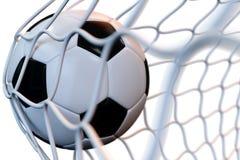 bola de futebol da rendição 3d no objetivo no movimento Bola de futebol na rede no movimento isolada no fundo branco Esfera 3d di Fotografia de Stock Royalty Free