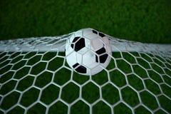 bola de futebol da rendição 3d no objetivo Bola de futebol na rede com fundo claro do projetor e do estádio, conceito do sucesso Imagem de Stock