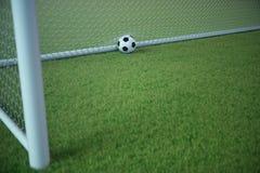 bola de futebol da rendição 3d no objetivo Bola de futebol na rede com fundo claro do projetor e do estádio, conceito do sucesso Fotos de Stock Royalty Free