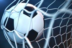 bola de futebol da rendição 3d no objetivo Bola de futebol na rede com fundo claro do projetor ou do estádio, conceito do sucesso Fotografia de Stock
