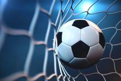 bola de futebol da rendição 3d no objetivo Bola de futebol na rede com fundo claro do projetor ou do estádio, conceito do sucesso Foto de Stock