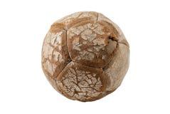 Bola de futebol de couro vestida velha pequena, isolada imagens de stock royalty free