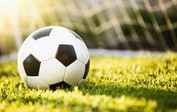 Bola de futebol do close up na grama verde Fotografia de Stock Royalty Free