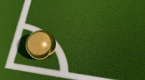 Bola de futebol dourada em um campo de futebol Copie o espaço no lado direito Fotografia de Stock Royalty Free