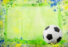 Bola de futebol e as cores da bandeira de Brasil Fotos de Stock Royalty Free