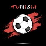 Bola de futebol e bandeira de Tunísia Imagem de Stock Royalty Free