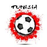 Bola de futebol e bandeira de Tunísia Foto de Stock
