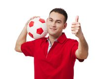 Bola de futebol guardando considerável feliz fotografia de stock royalty free