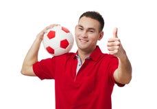 Bola de futebol guardando considerável feliz foto de stock royalty free