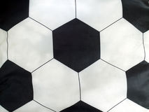 Bola de futebol listrada do descanso Imagens de Stock