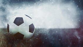 A bola de futebol na grama como o grunge ostenta o fundo Imagens de Stock