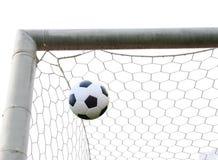 Bola de futebol na rede do objetivo isolada Fotografia de Stock