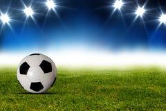 Bola de futebol no estádio Fotos de Stock Royalty Free