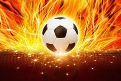 Bola de futebol no fogo imagens de stock