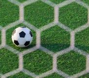 Bola de futebol no objetivo Fotos de Stock Royalty Free