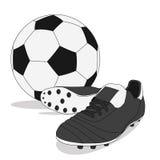 Bola de futebol preto e branco com sapatas do parafuso prisioneiro Foto de Stock Royalty Free