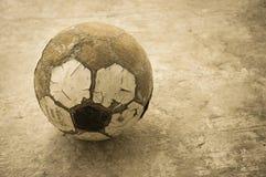 Bola de futebol velha Imagens de Stock Royalty Free