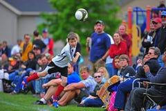 Bola de la pista del fútbol de la juventud Imágenes de archivo libres de regalías