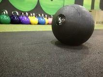 Bola de medicina no gym imagem de stock royalty free