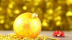 Bola de oro de la Navidad Bokeh de oro borroso que brilla tenuemente Decoración del Año Nuevo 00176 metrajes