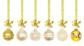 Bola de oro de las chucherías del Año Nuevo de la Navidad Fotos de archivo