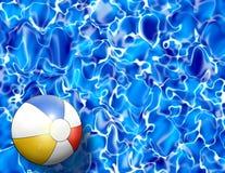 Bola de playa en agua de la piscina Fotografía de archivo libre de regalías