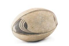 Bola de rugbi gastada con el recortes Fotografía de archivo libre de regalías